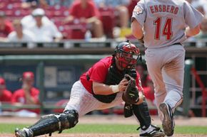 Javier Valentin of the Cincinnati Reds looks to place the tag on Morgan Ensberg of the Houston Astros  in 2005. What are the nine positions in baseball? See more sports pictures.