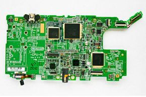 This is the main circuitboard inside the Nintendo 3DS. You can see the CPU, GPU, accelerometer, gyroscope and other chips the 3DS needs to make 3-D gaming possible.