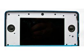 This is what the Nintendo 3DS's 3-D screen looks like with the protective covering removed. You can see the speakers mounted to either side of the screen.