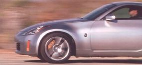 Even with standard brakes, the 350Z was designed to deliver short, sure stops. The gold calipers shown reveal these as the available Brembo-brand brakes.