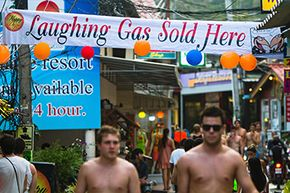 A sign advertising laughing gas is prominently displayed in the party island of Ko Phangan, Thailand.