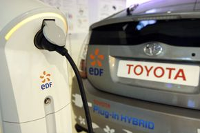 Image Gallery: Electric Cars In 2007, a demonstration in Paris showcases a Toyota Prius modified as a plug-in. See more electric car pictures.