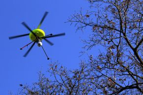 During a training exercise simulating a nuclear accident, a drone equipped with cameras and sensors is deployed to assess contaminated areas.