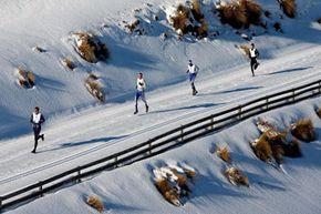Winter triathletes trudge through the snow during the winter triathlon at the 2009 Winter Games NZ in Wanaka, New Zealand.