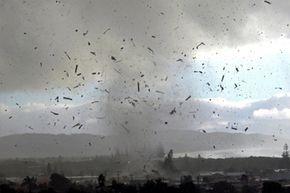 Debris flies through the air during a freak tornado