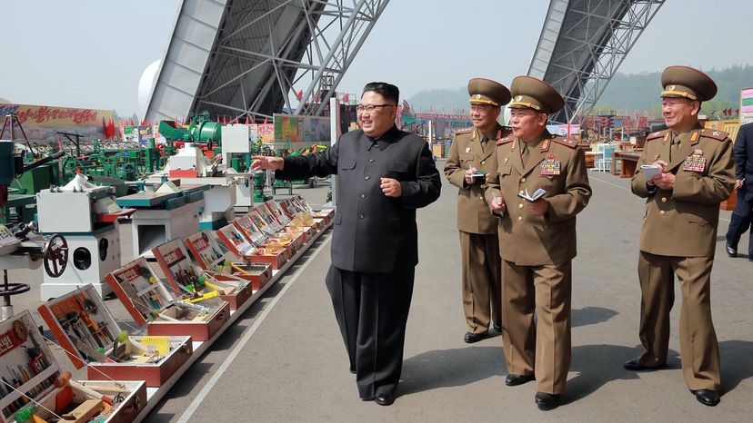 North Korean leader Kim Jong Un (L) visits an exhibition of  building materials and sci-tech achievements organized by the Ministry of the People's Armed Forces. AFP PHOTO/KCNA VIA KNS/Getty Images