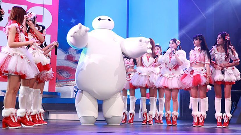 """An actor portraying the robot character Baymax from """"Big Hero 6"""" appears onstage at a Shangai Disney resort with the pop group SNH48. VCG/Getty Images"""
