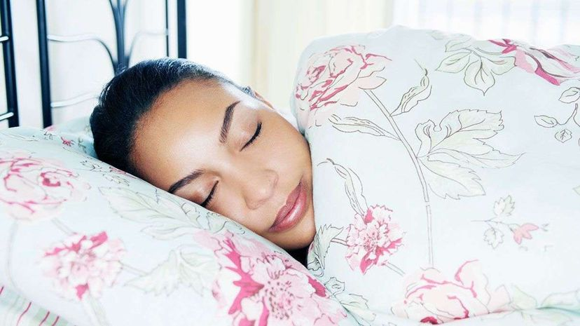 In addition to light and sound, temperature also affects whether you get a good night's sleep. Tara Moore/Getty Images