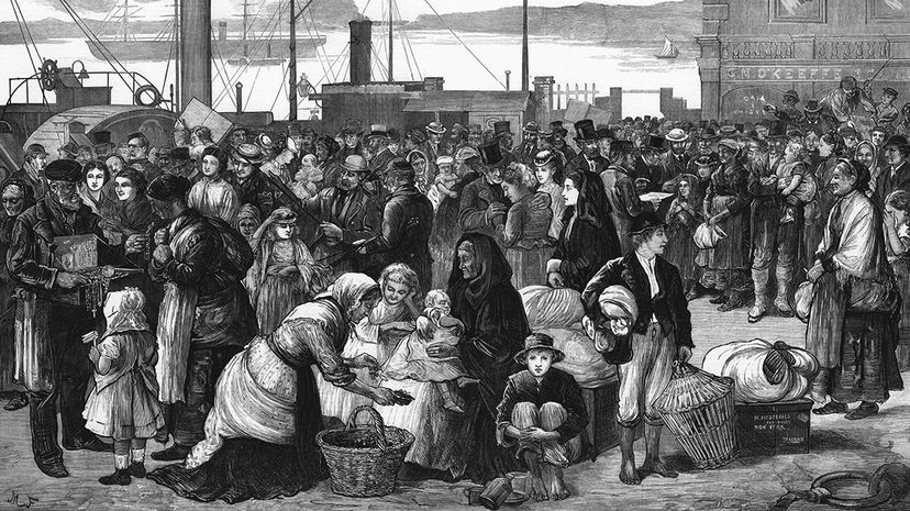 An 1874 engraving published in The Illustrated London New shows Irish emigrants preparing to leave the Queenstown port in Cork for the United States. Ann Ronan Pictures/Print Collector/Getty Images