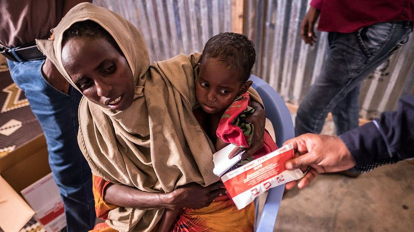 A mother and child receive peanut paste at the Turkish Red Crescent's Baydhabo camp near Mogadishu in Somalia in March 2017. Somalia is in the grip of an unprecedented and devastating food crisis threatening 6.2 million people, more than half its population. Maciej Moskwa/NurPhoto via Getty Images