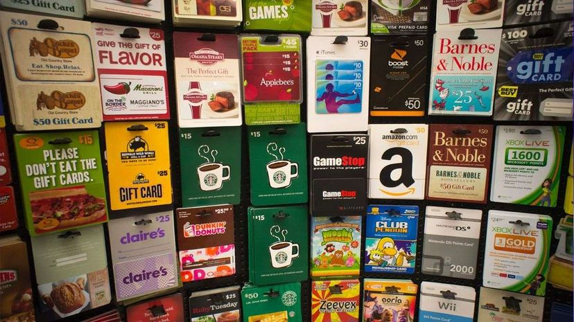 A lot of people give gift cards as presents during the winter holidays. Starbucks, for example, sold almost 2.5 million gift cards in the U.S. and Canada on Christmas Eve in 2014. Richard Levine/Corbis via Getty Images