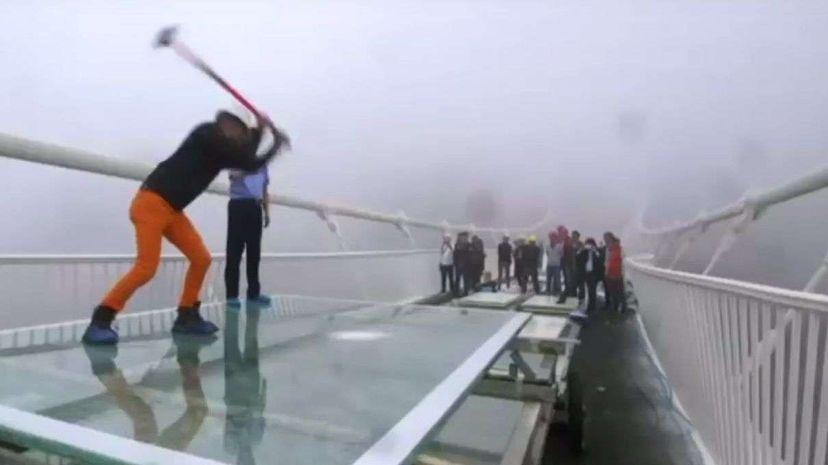 China's glass bridge hit with sledge hammer BBC News/YouTube