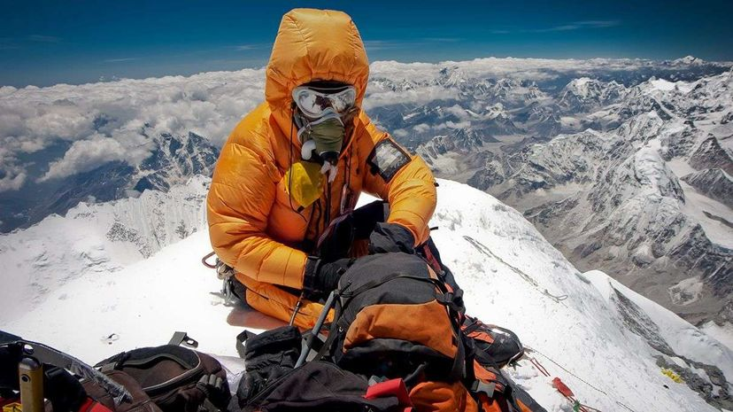 The ultimate selfie? A climber rests alone on the summit of Mount Everest. Harry Kikstra/Getty Images