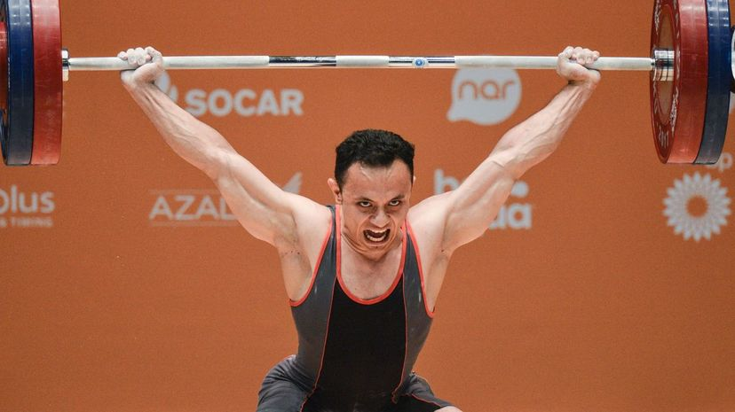 Ahmed Saad of Egypt competes in the Men's 62kg Weightlifting final during the 2017 Islamic Solidarity Games in  Baku, Azerbaijan. Artur Widak/NurPhoto via Getty Images