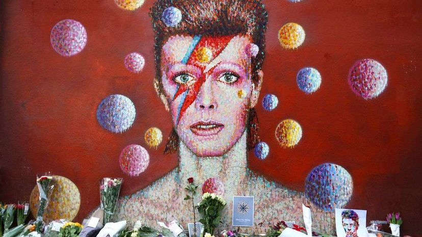 A makeshift memorial appeared under a London mural of David Bowie following the singer's death on January 10, 2016. Carl Court/Getty Images