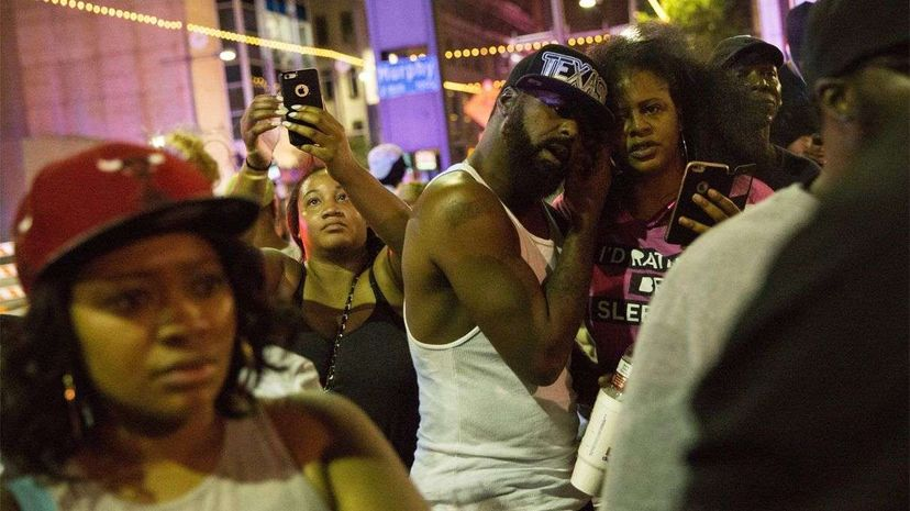 This photo of protesters was taken after police officers arrested a bystander following the shootings in Dallas on July 7, 2016. LAURA BUCKMAN/AFP/Getty Images