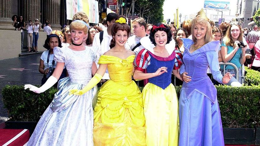 """Disney princess characters pose during """"The Princess Diaries"""" premiere at El Capitan Theatre in Hollywood, California. SGranitz/WireImage/Getty Images"""