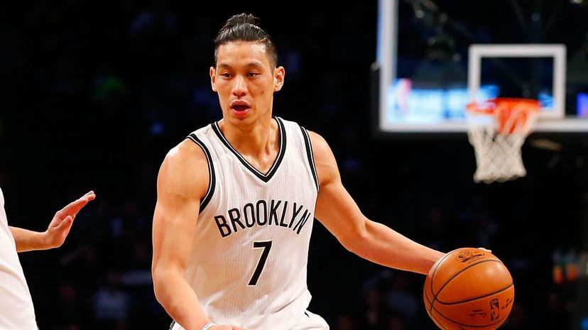 """Jeremy Lin ignited """"Linsanity"""" in 2012 when he led the New York Knicks to a winning turnaround. Lin remains one of the few Asian-American NBA players and is now with the Brooklyn Nets. Jim McIsaac/Getty Images"""