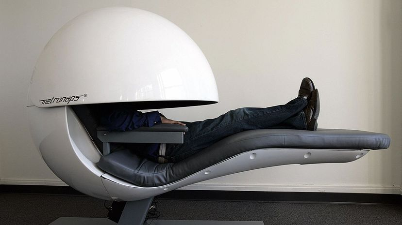 Some high school students are getting the opportunity to take a midday snooze in comfy pods. STAN HONDA/AFP/Getty Images