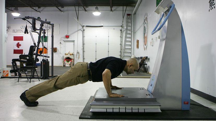 "Dr. Jasper Sidhu demonstrates the ""WAVE"" (Whole Body Advanced Vibration Exercise) machine. Jim Ross/Toronto Star via Getty Images"