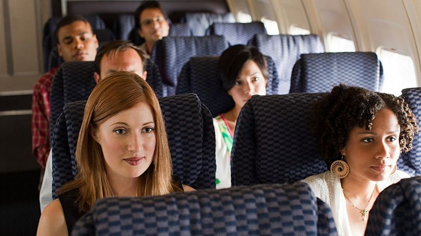 Analysis shows that the average space between a passenger's head and the next seat forward has been steadily decreasing. Image Source/Getty Images