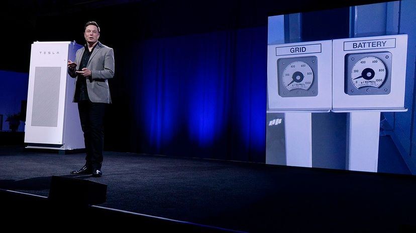 Tesla CEO Elon Musk, with a Powerpack system in the background, unveils a suite of batteries for homes, businesses and utilities. Musk thinks Tesla could help Australia with its energy problems  and quickly. Kevork Djansezian/Getty Images