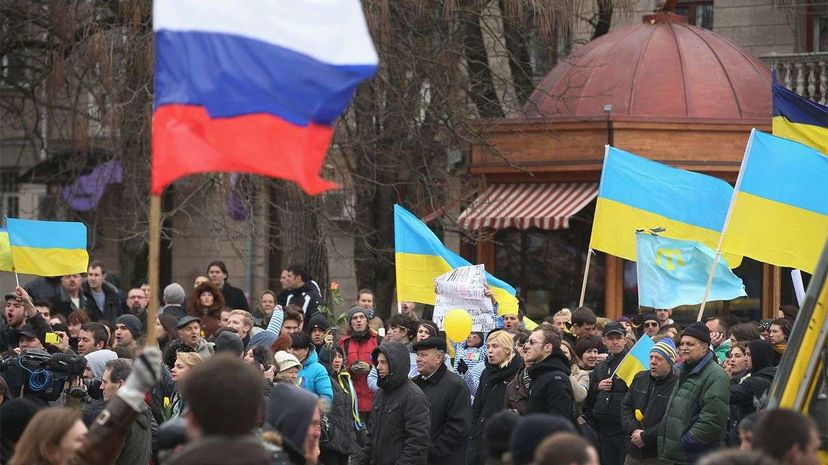 Pro-Russian sympathizers bearing a Russian flag march past pro-Ukrainian sympathizers gathered and waving Ukrainian flags on March 8, 2014 in Simferopol, Ukraine. Sean Gallup/Getty Images