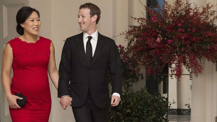 Mark Zuckerberg, and his wife, Priscilla Chan, arrive for a state dinner hosted by President Barack Obama for Chinese President Xi Jinping at the White House, just a few months before the birth of their baby Max. Molly Riley/AFP/Getty