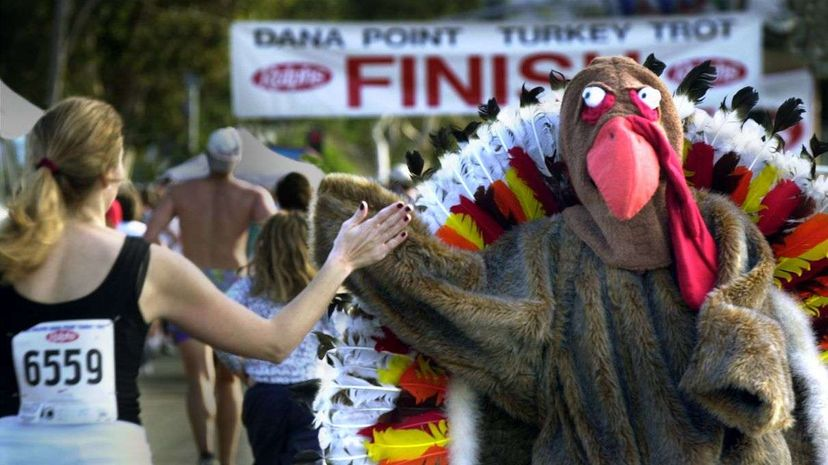 Thanksgiving Day fun runs often appeal to nonprofessional runners with a more mellow pace (and even people wearing costumes). Don Bartlett/Getty Images