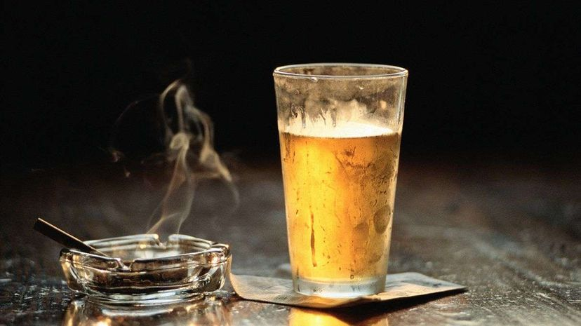 What's with the common combo of smoking and drinking? Well, a cigarette acts as a stimulant and wards off the sleepiness that comes with drinking one too many. Don Tremain/Getty Images