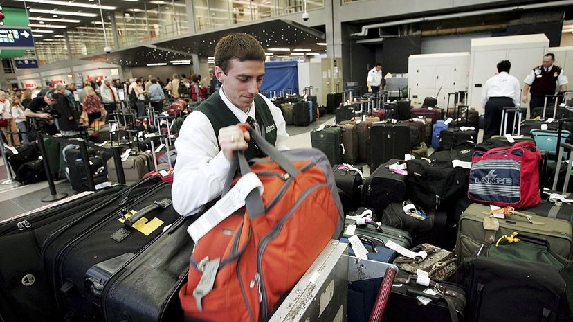 Once luggage has been checked with an airline, it's subject to search either through scanning or more physical means. Scott Olson/Getty Images