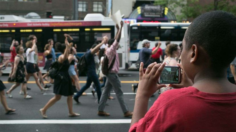 A young boy captures the Black Lives Matter protest on his smartphone on July 7, 2016. Social media, and live-streaming in particular, have played a big role in calls for social justice recently. Karla Ann Cote/NurPhoto via Getty Images