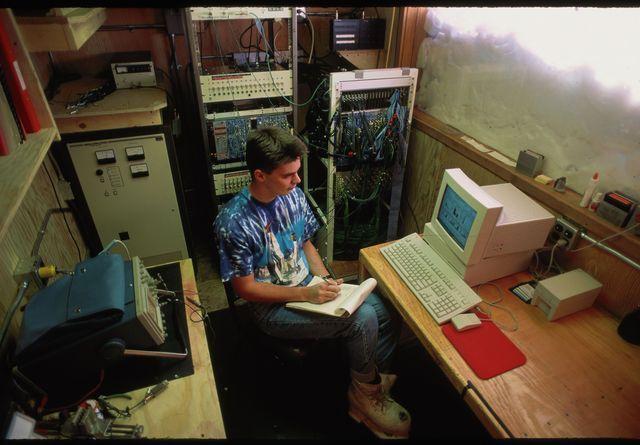 scientist monitors gamma ray data
