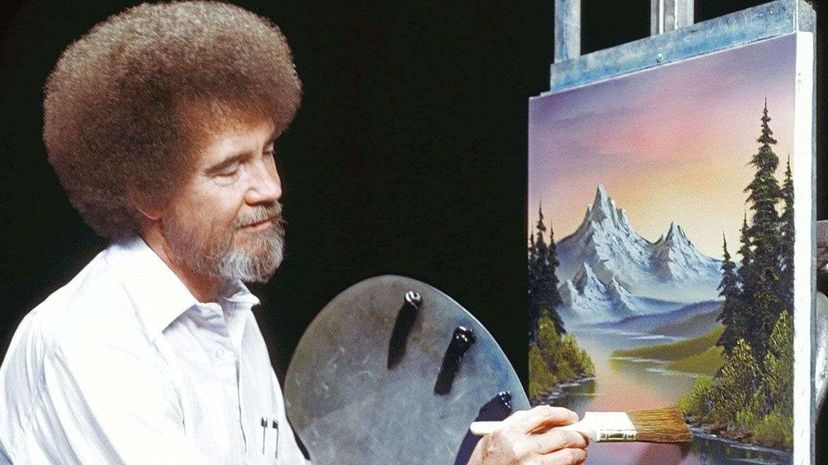 """Bob Ross paints a signature landscape with his """"almighty"""" brush. Bob Ross Inc"""