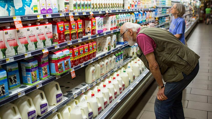 The difference in fat content between whole, 2 percent, 1 percent and fat-free milk may not be what you assume. Robert Nickelsberg/Getty Images