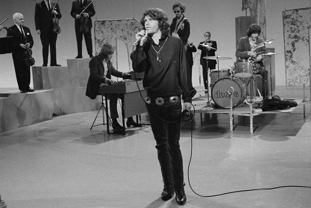 Jim Morrison and rest of The Doors (l-r Ray Manzarek, Robby Krieger and John Densmore) perform on 'The Smothers Brothers Comedy Hour' in 1969.