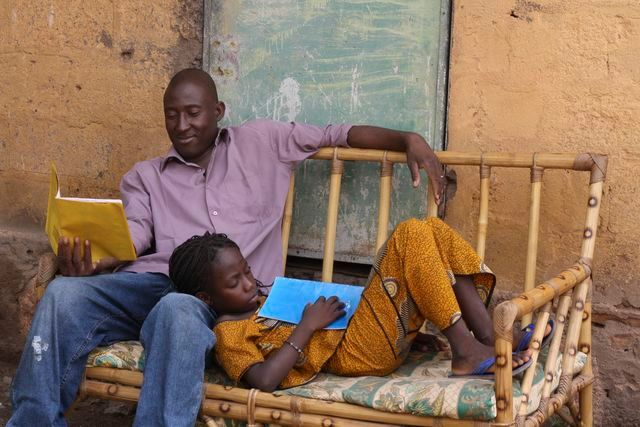 A father and daughter read books