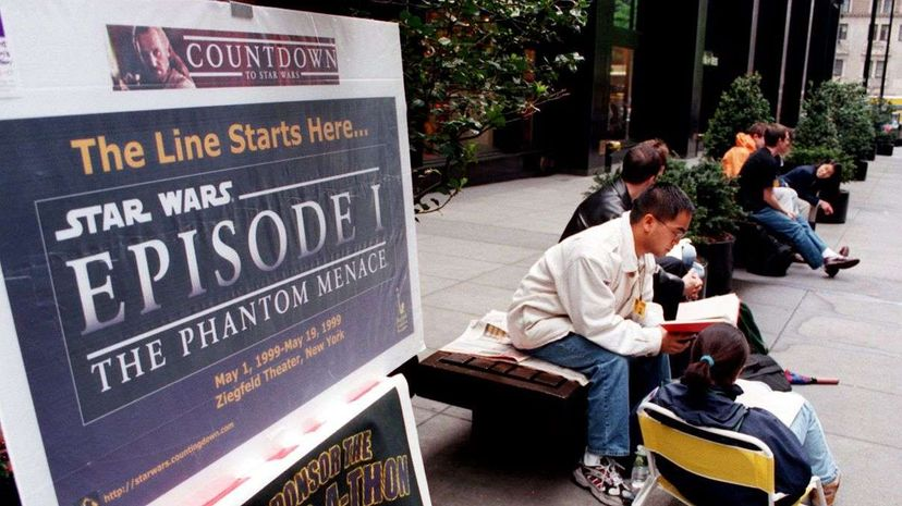 """Fans camping out in line at the Ziegfeld Theatre in New York for the opening of """"The Phantom Menace"""" in 1999. STAN HONDA/AFP/Getty Images"""