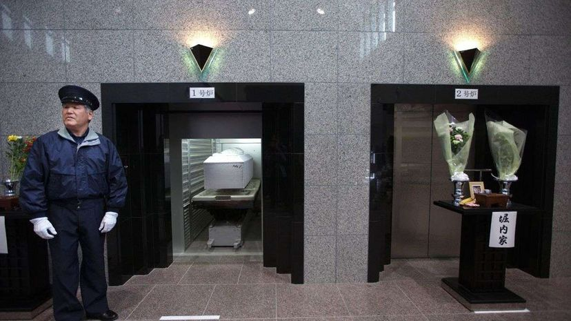 'Corpse Hotels' in Japan Carousel: Paula Bronstein/Getty Images; Video: Reuters
