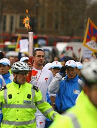 England cricket player Kevin Pietersen carries the Olympic Torch on April 6, 2008 in London, England.