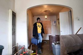 Marquita Ealy of the Richmond, California chapter of the Alliance of Californians for Community Empowerment (ACCE) tours a foreclosed home. Foreclosure is one of the risks you take if you buy a home before you are ready.