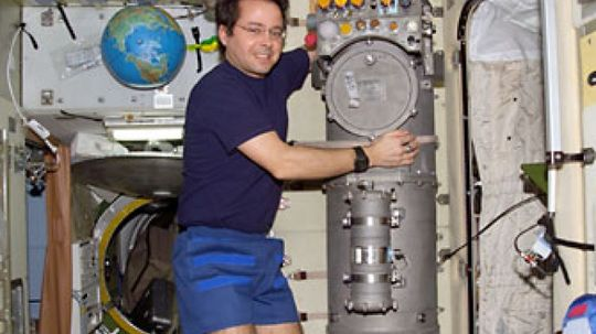How is oxygen made aboard a spacecraft?