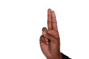 Keeping your fingers crossed is a good luck sign in the West; in Vietnam, it symbolizes a woman's private parts.