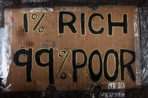 """Occupy Wall Street protests on behalf of the """"99 percent."""" See more protesting pictures."""