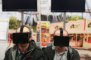 Visitors to the 2013 IFA electronics trade fair in Berlin, Germany take the Oculus Rift for a test drive.