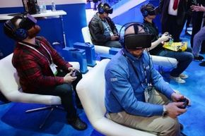 """Attendees playing """"EVE: Valkyrie"""" at the Intel booth at the 2014 International CES in Las Vegas, Nevada."""