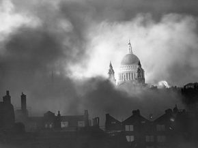 St. Paul's cathedral stands above the smoke of burning buildings during the London Blitz.