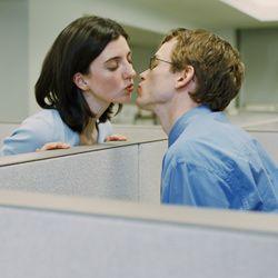 So you say a quick kiss helps your sweetheart concentrate better on work? The rest of the office says it makes them sick.