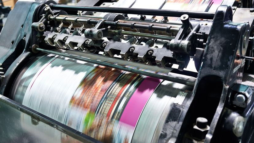 Offset printer printing out posters
