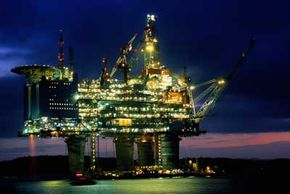 An enormous offshore platform lights up the night off the coast of Norway.